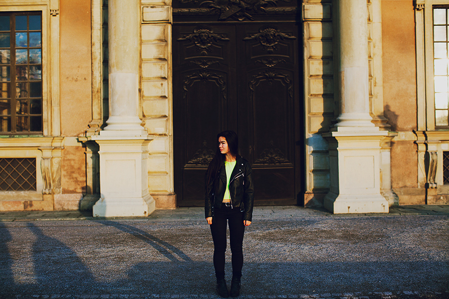 Girl in front of the doors to the royal castle