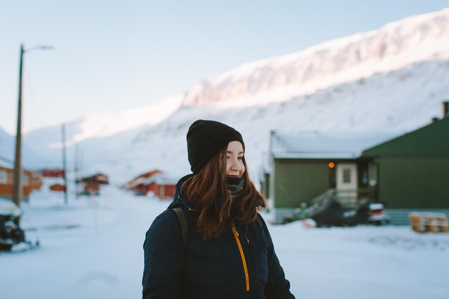 Girl walking in winter landscape