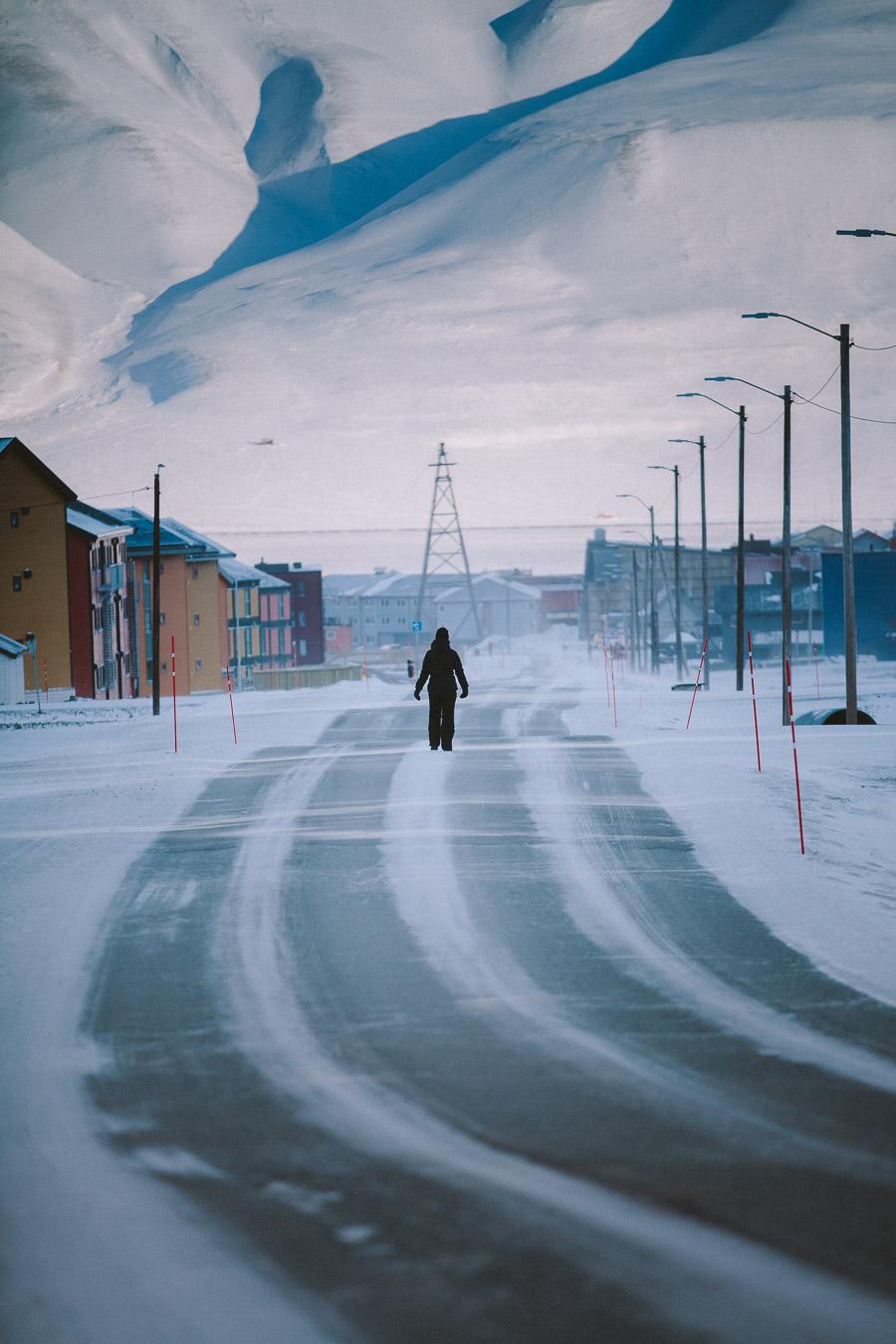 Person walking down a snowy street