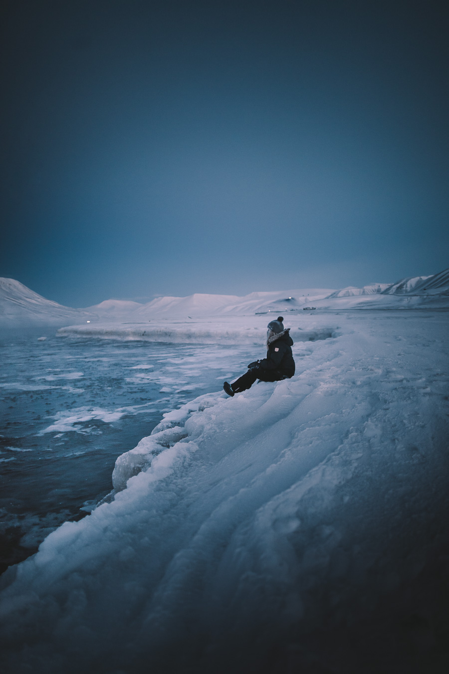 Girl sitting on the edge of the world