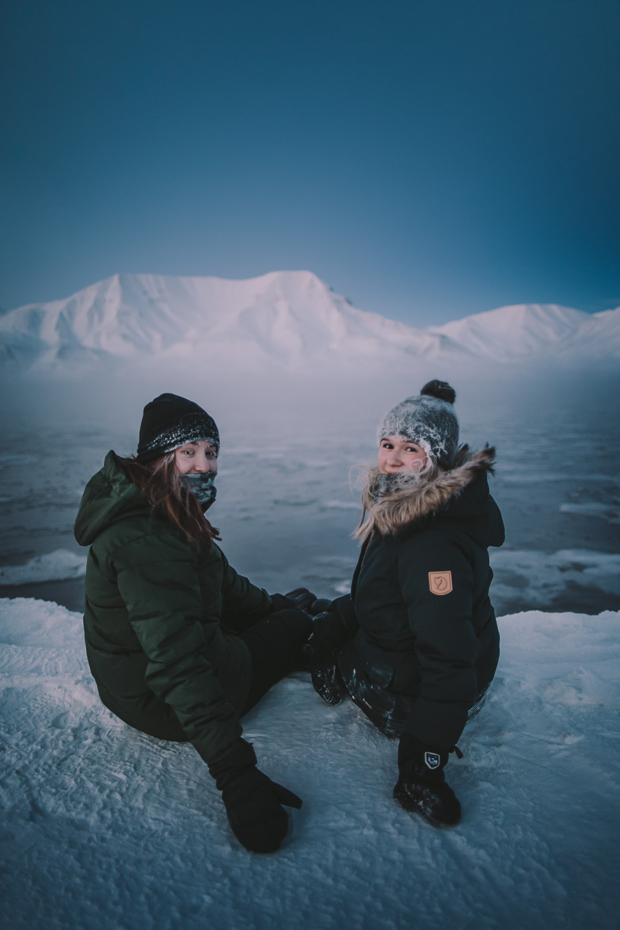 Girls smiling with an icy backdrop