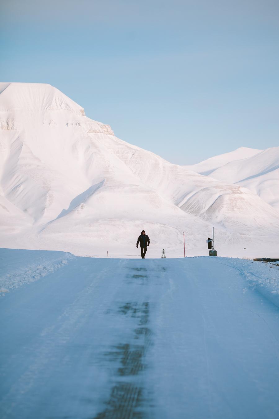 Man walking on icy snow