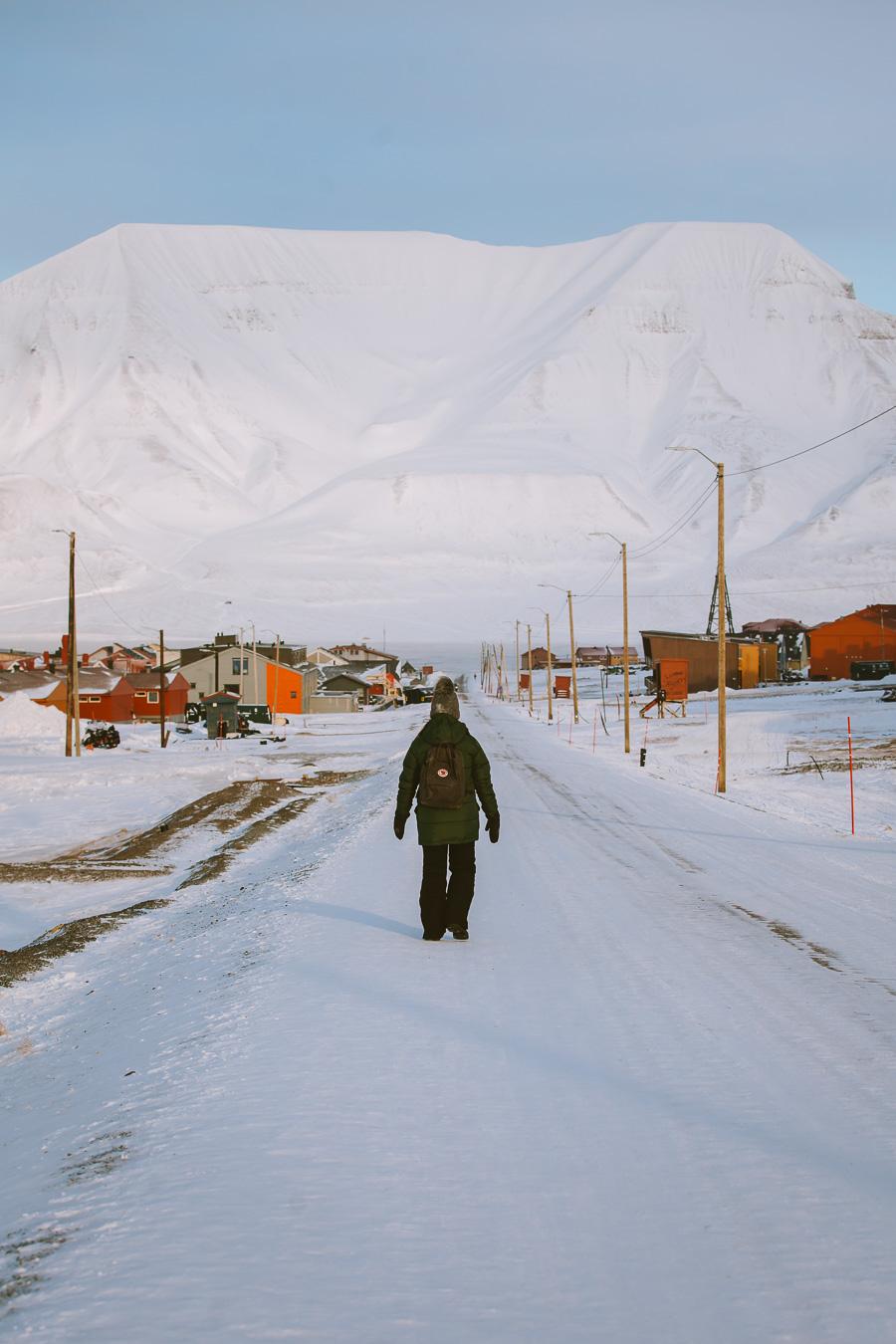 Girl walking on the road in Longyearbyen