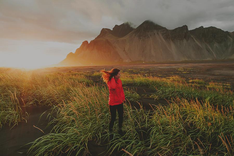 Girl enjoying the sunset at Stokksnes