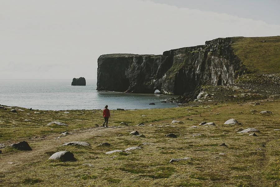 Girl walking in Icelandic landscape