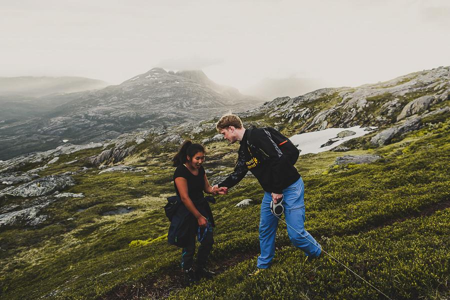Boy and girl having fun on a hiking trip