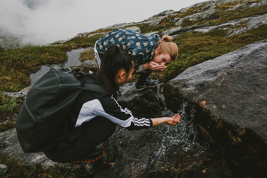 Boy and girl drinking water