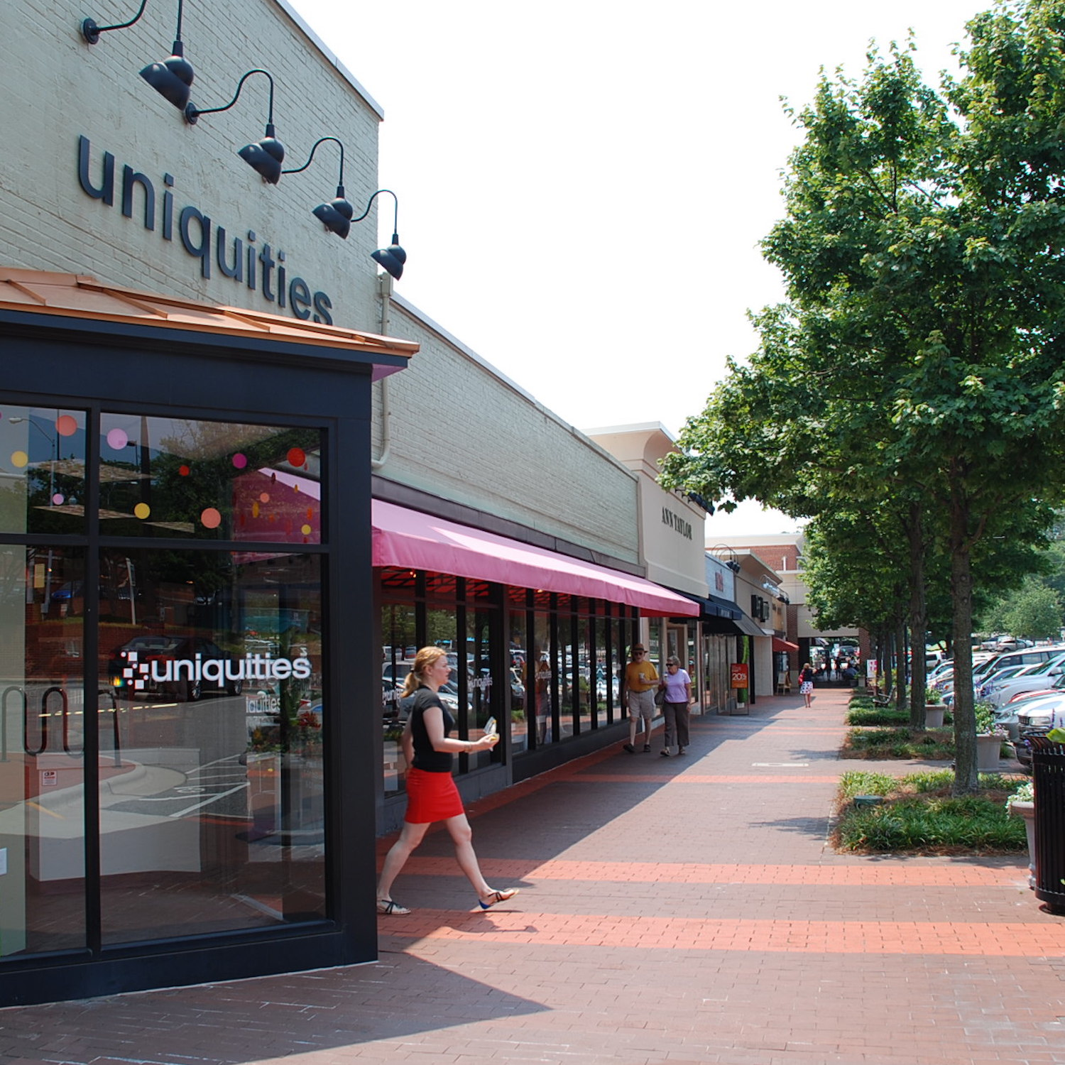 A woman walking out of a boutique in Cameron Village.