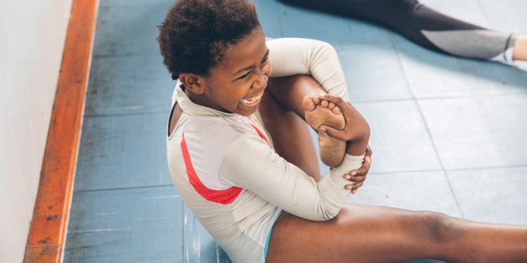One of Move For Two's students stretching before a dance routine