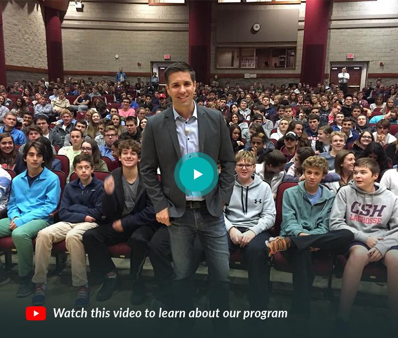 Josh Ochs standing in front of students