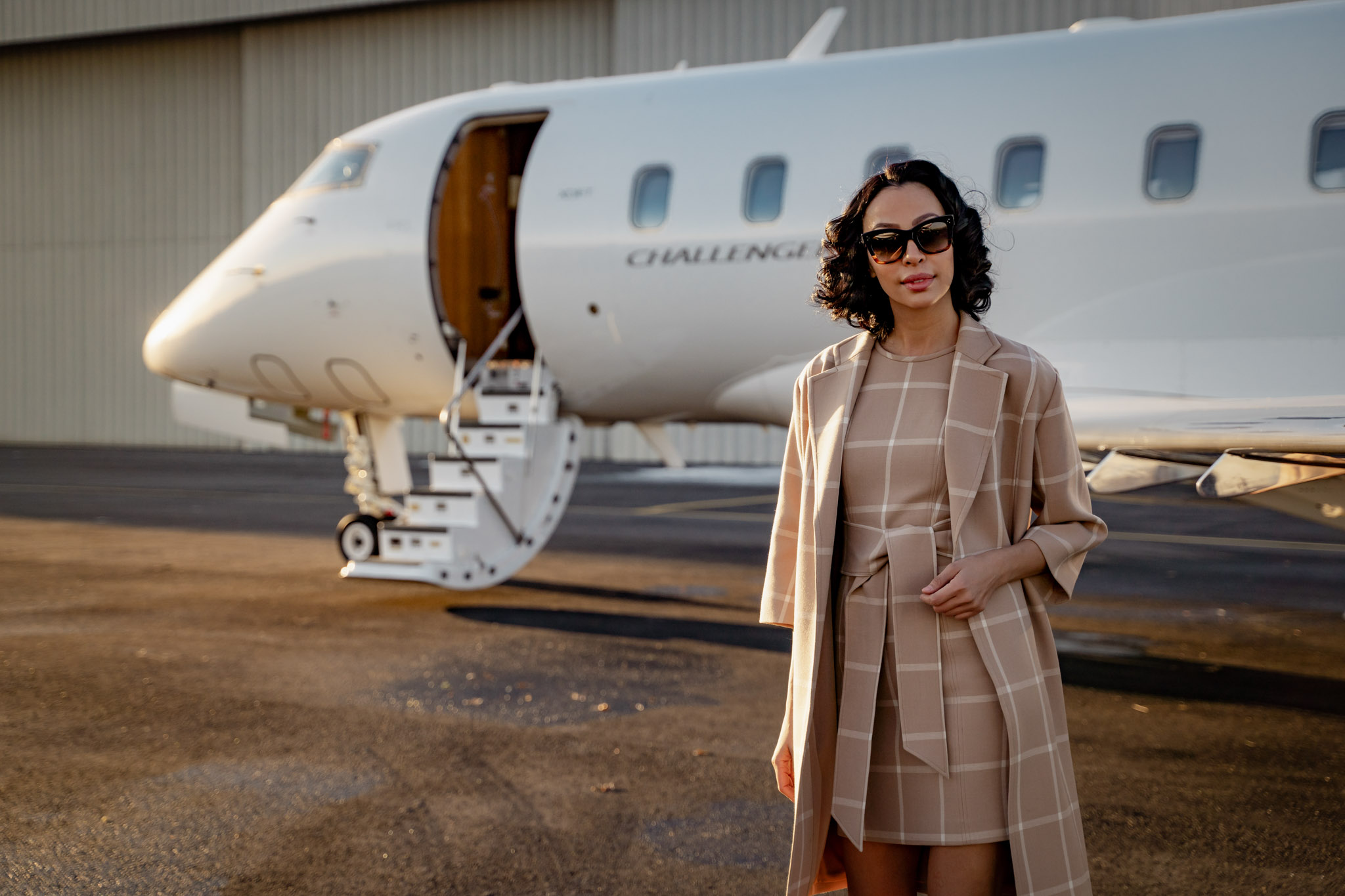 visual content creator in New York working with model on campaign for private jet company