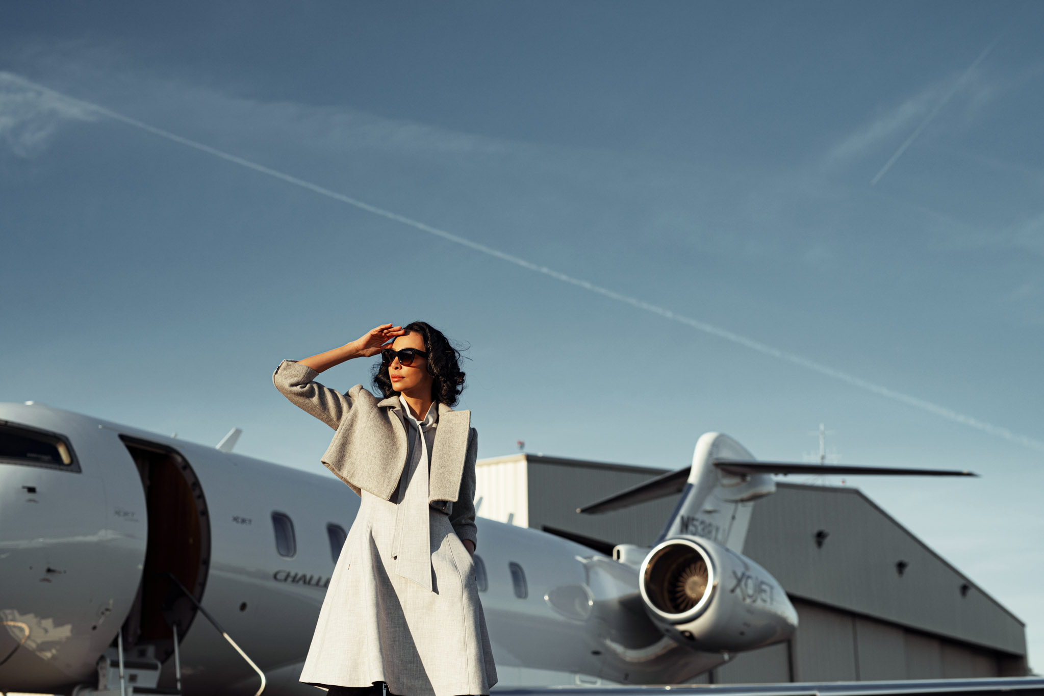 Private jet advertisement photoshoot with model