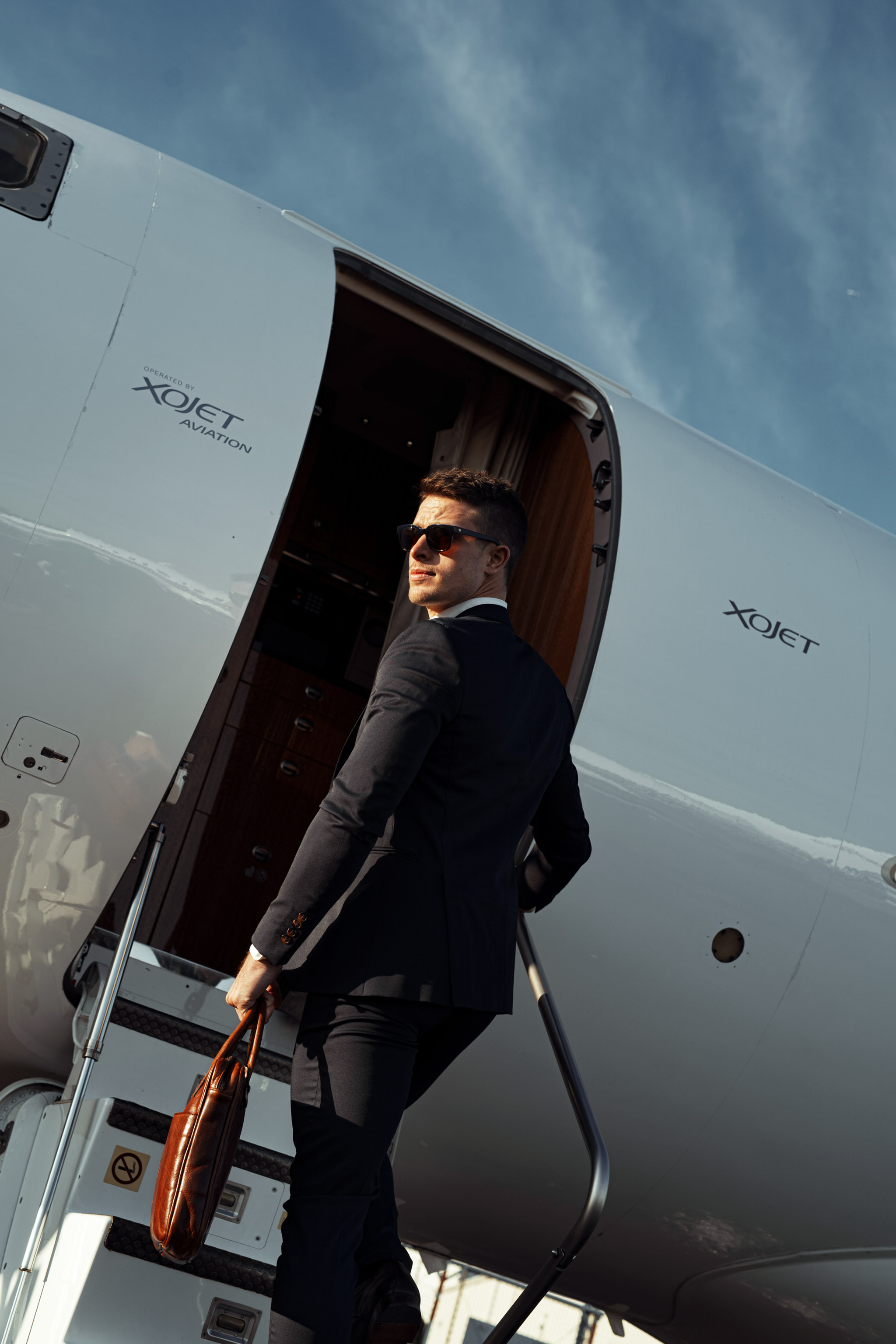 commercial photoshoot of entrepreneur arrived on private jet