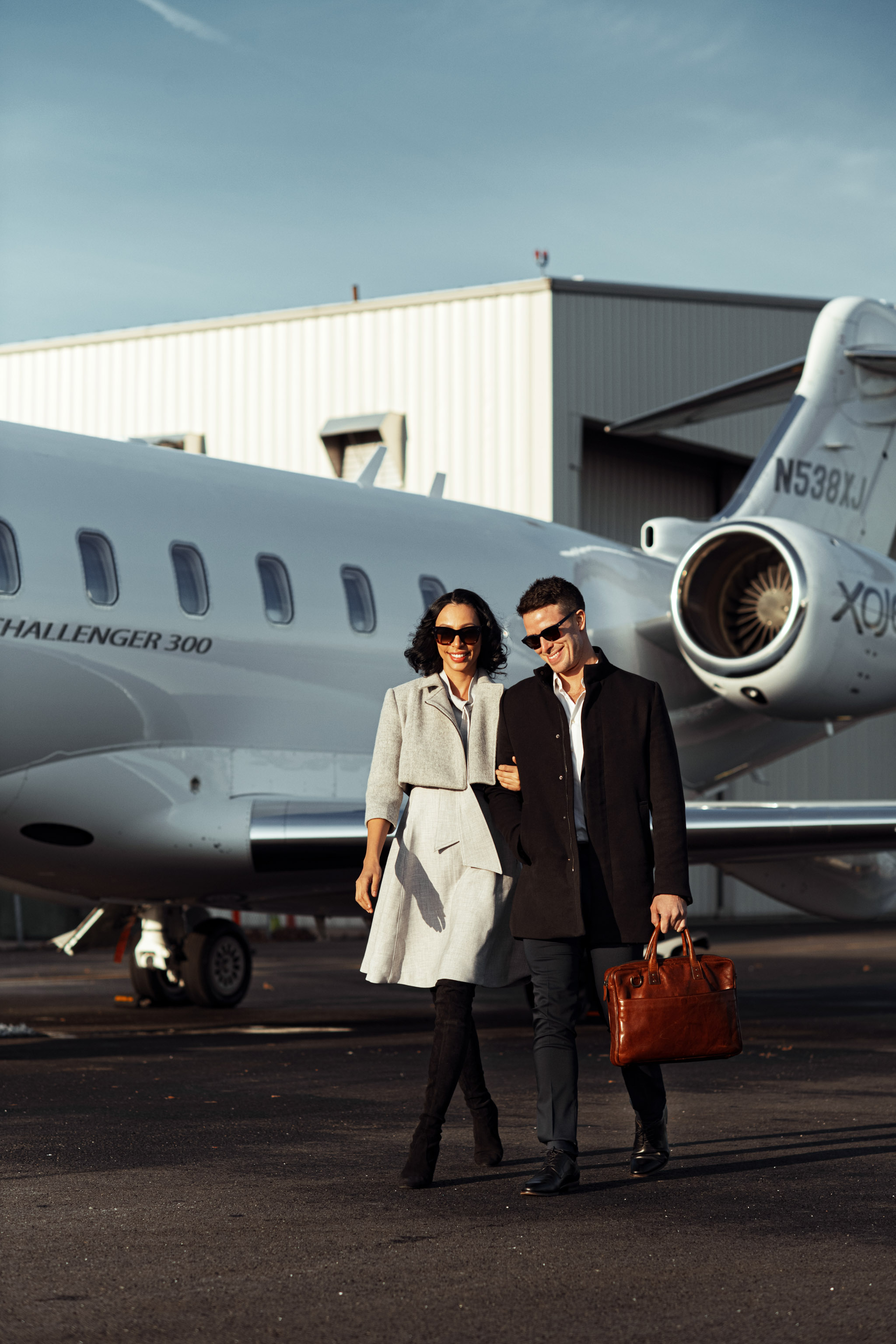 commercial photoshoot of couple against XOjet in teterboro Airport