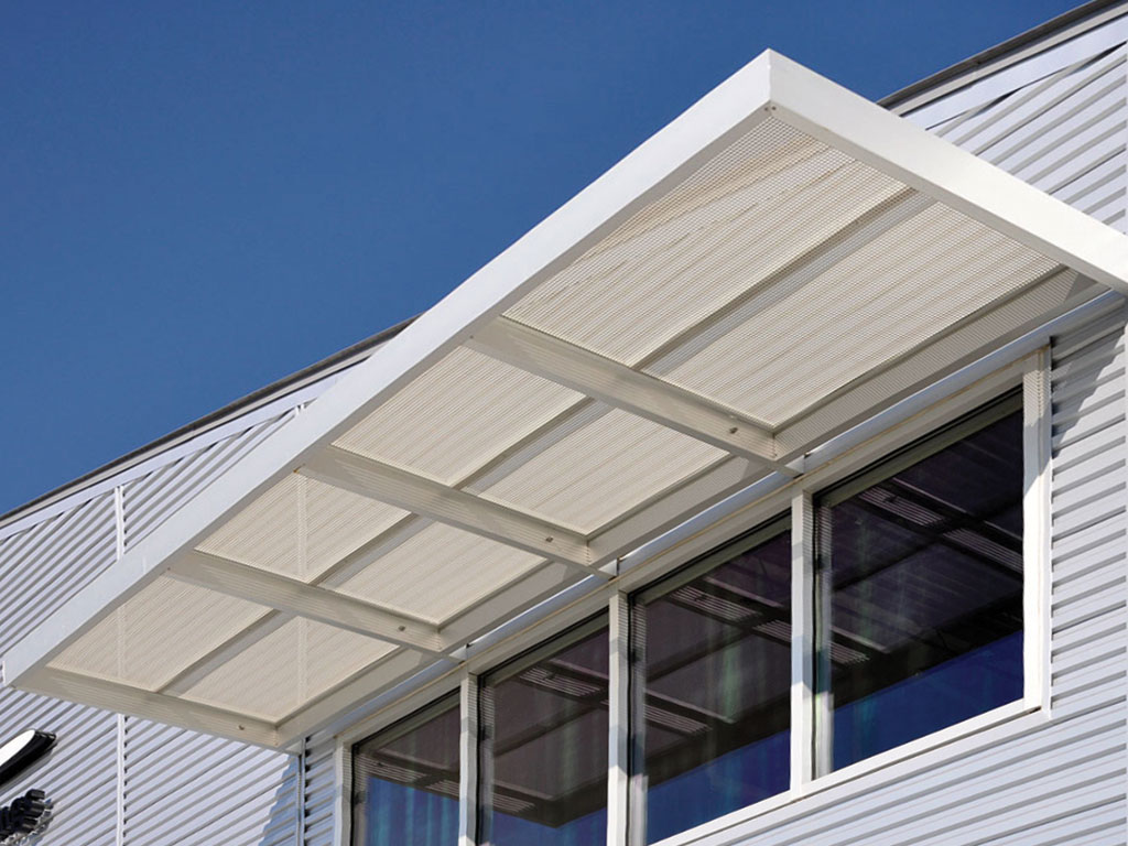 aluminum sunshades attached to building