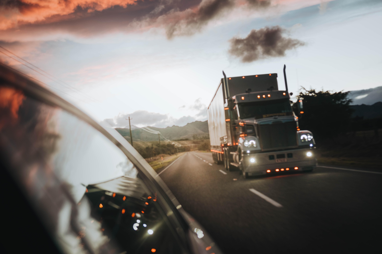 truck in side mirror of car