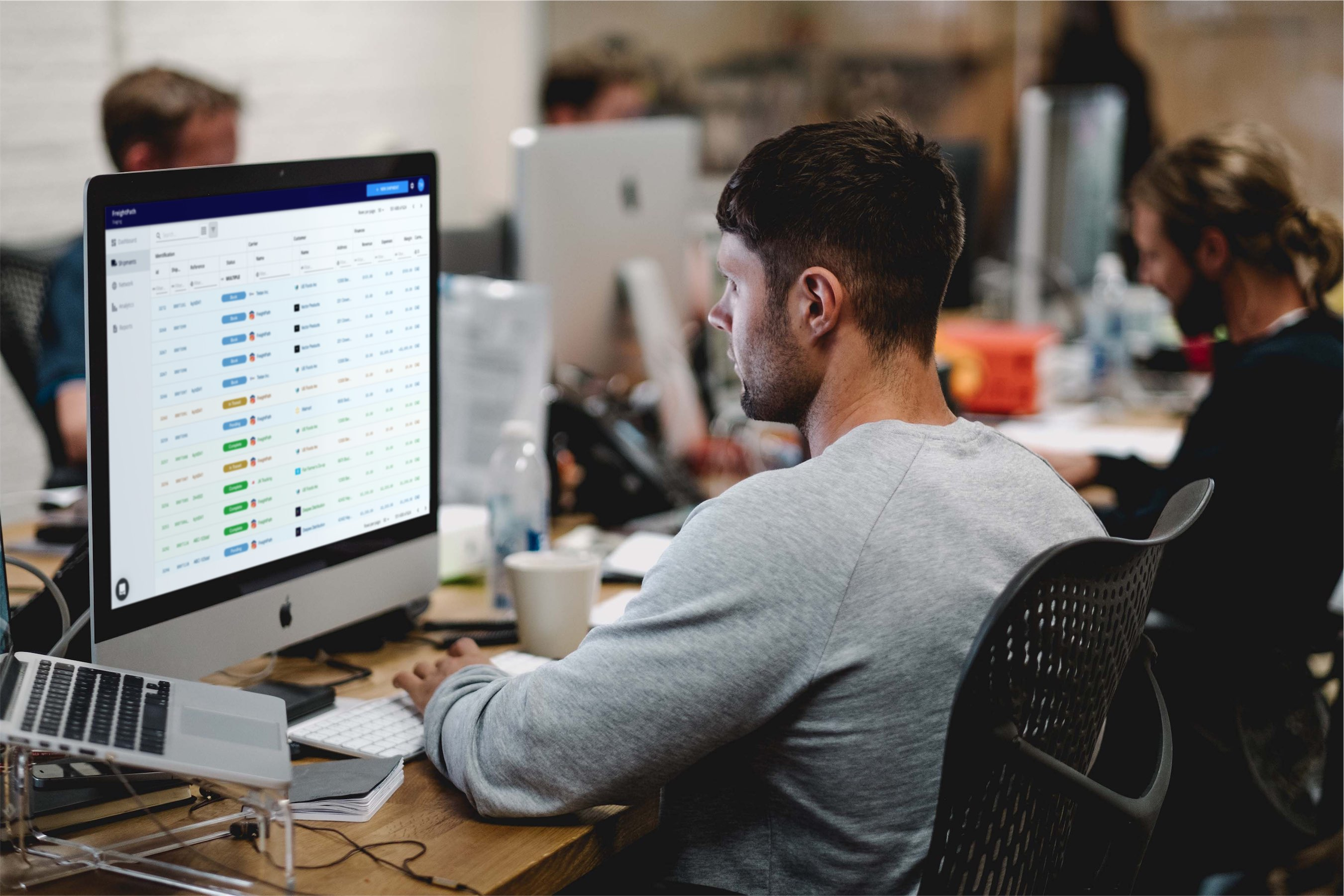 man sitting at office desk using computer