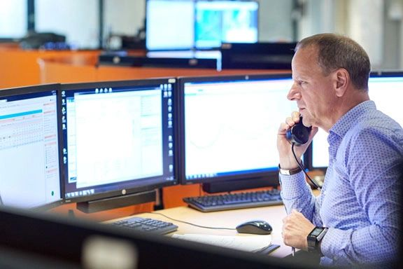 freightpath man looking at computer screens freight broker on phone innovative software solution business enterprise tms software freight broker 3PL
