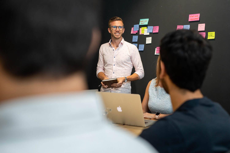 A man mentoring a team in an office