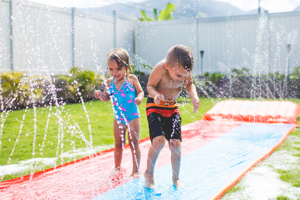 Children enjoying water and slip and slide.