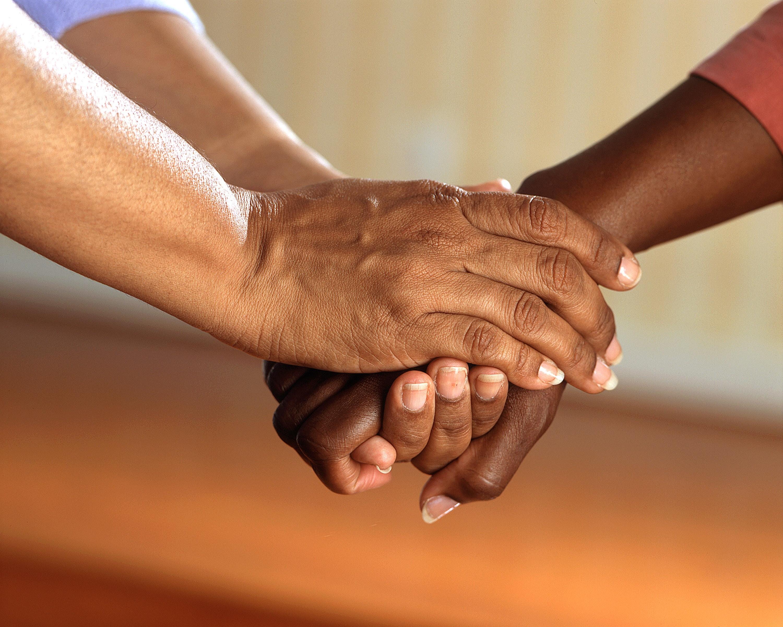 hands holding in comfort