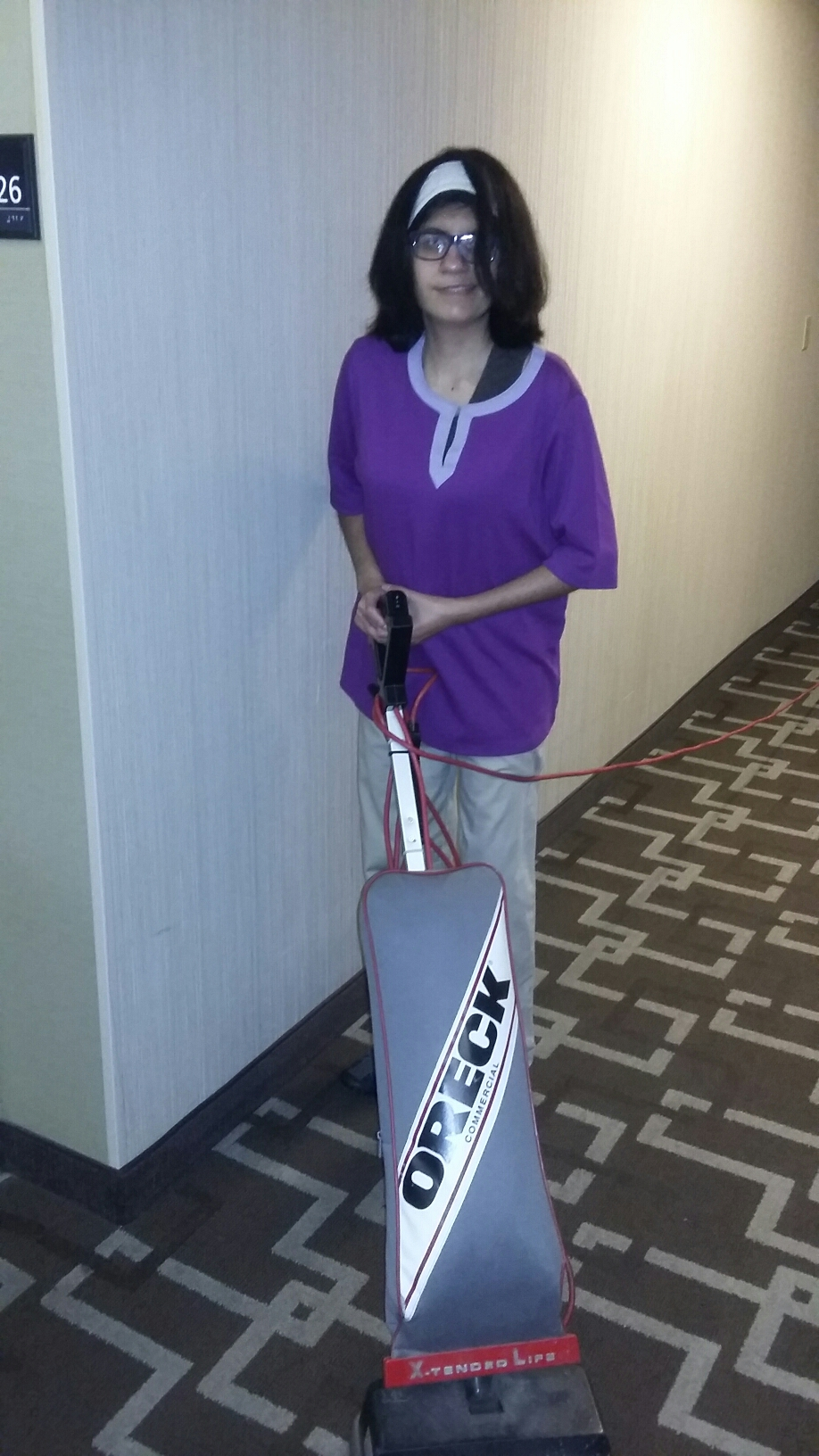 woman standing with vacuum cleaner