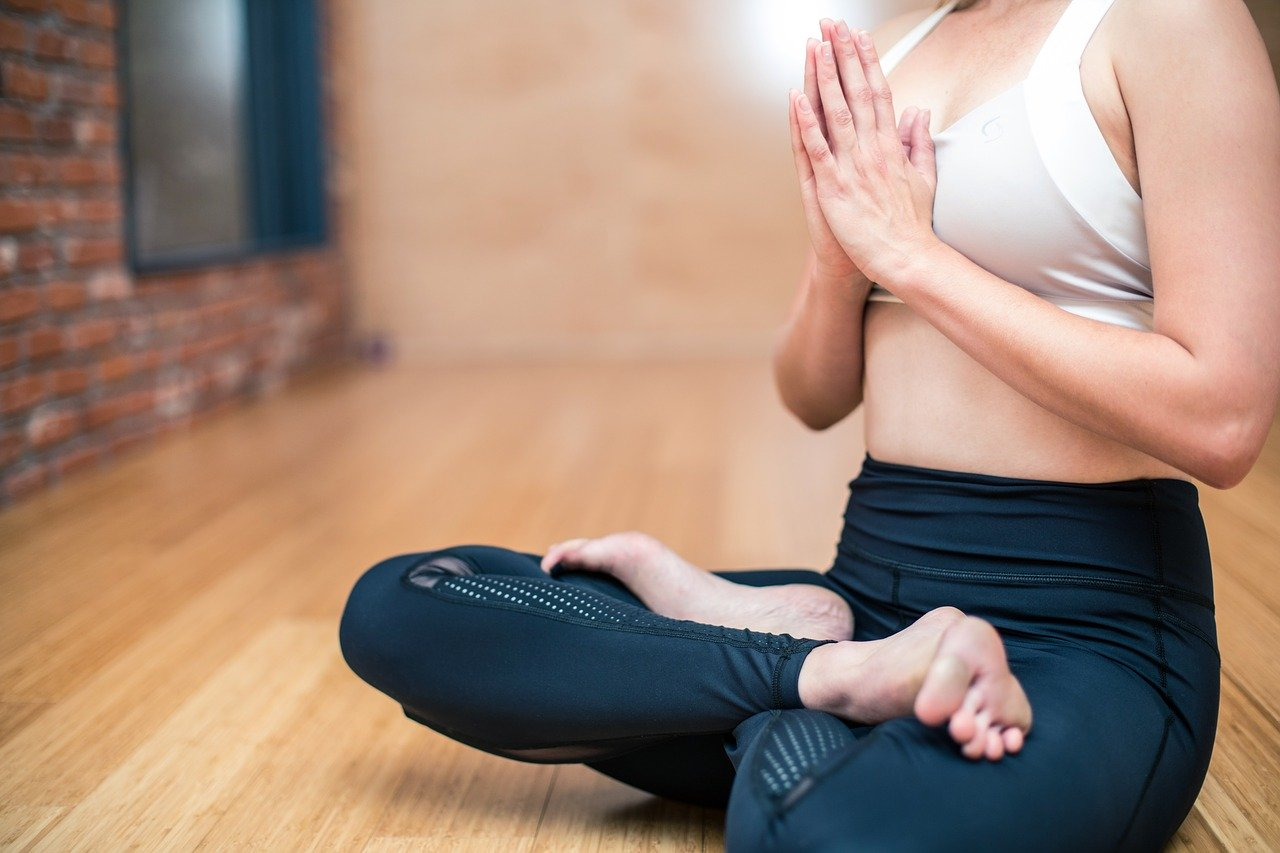 woman cross-legged in yoga pose