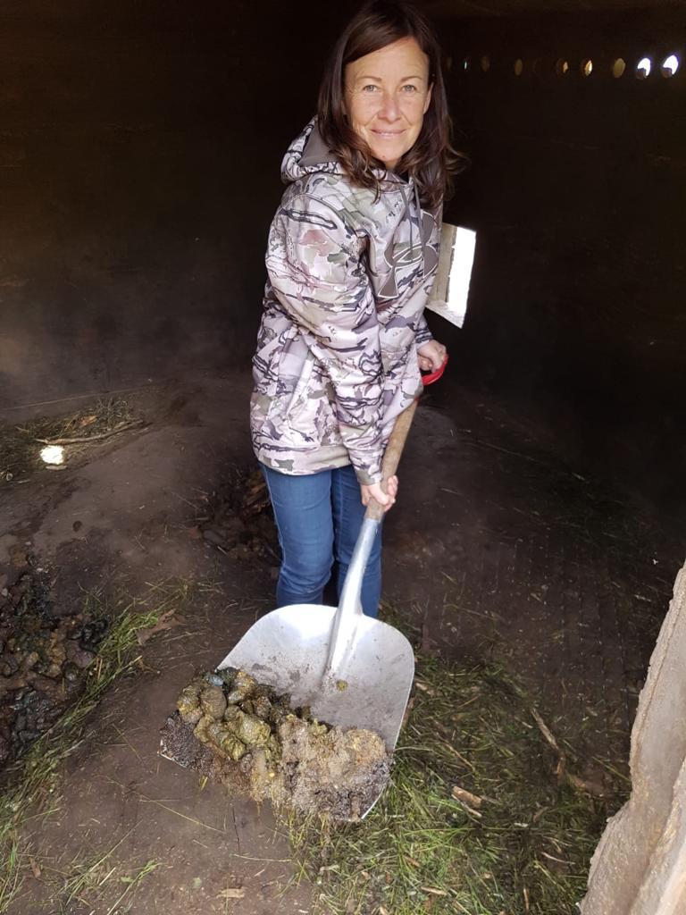 Jennifer Marriott keeping things clean in one of the bear dens.
