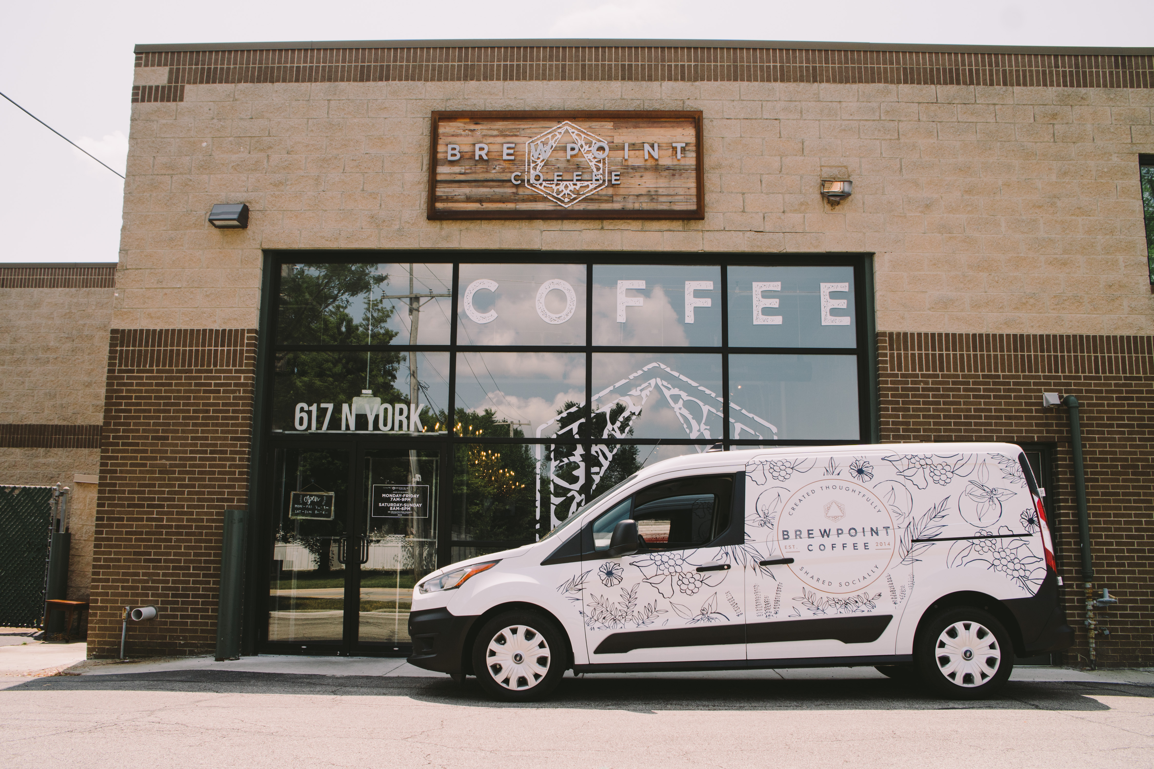 Vehicle wrap design for Brewpoint Coffee.