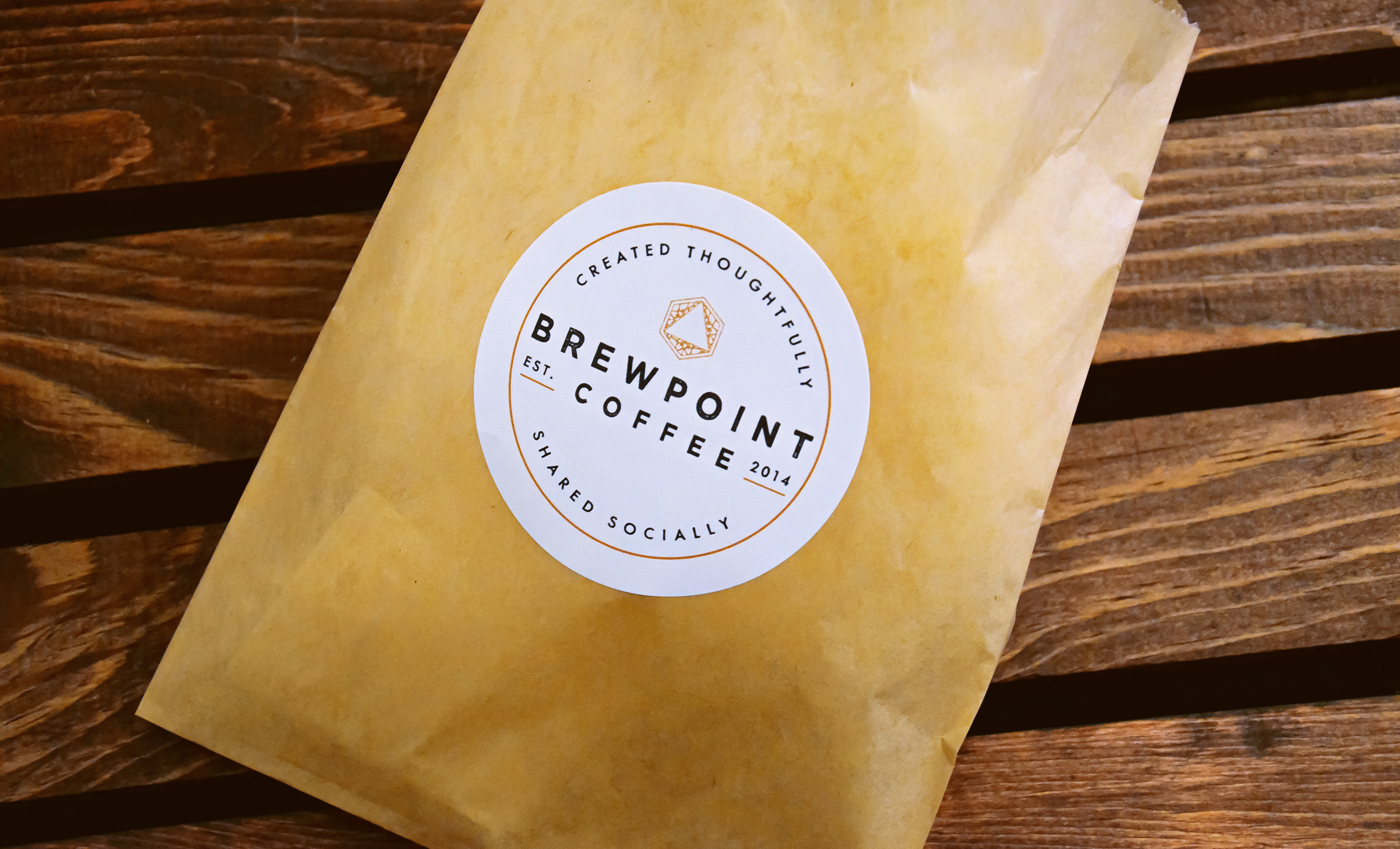 Brewpoint Coffee's logo stamp on a pastry bag.