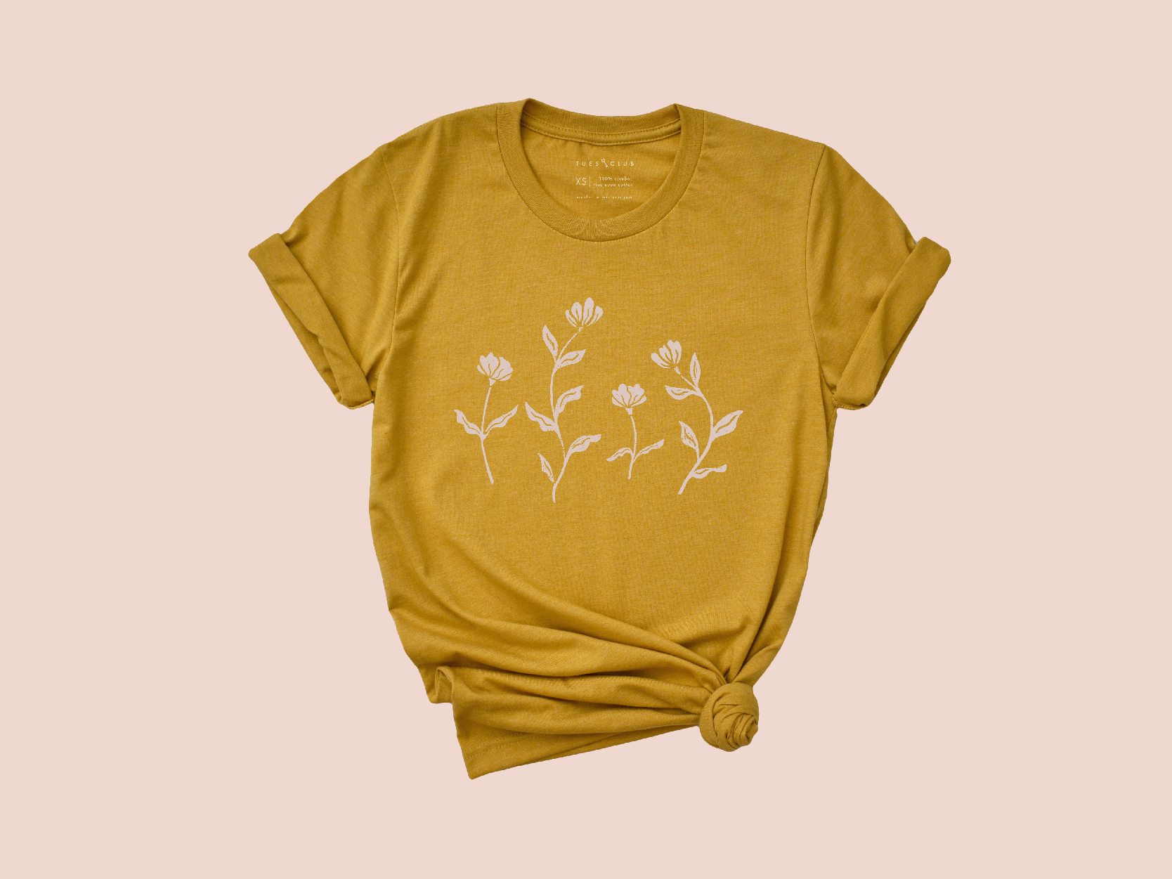 Mustard colored shirt with light pink wildflowers.