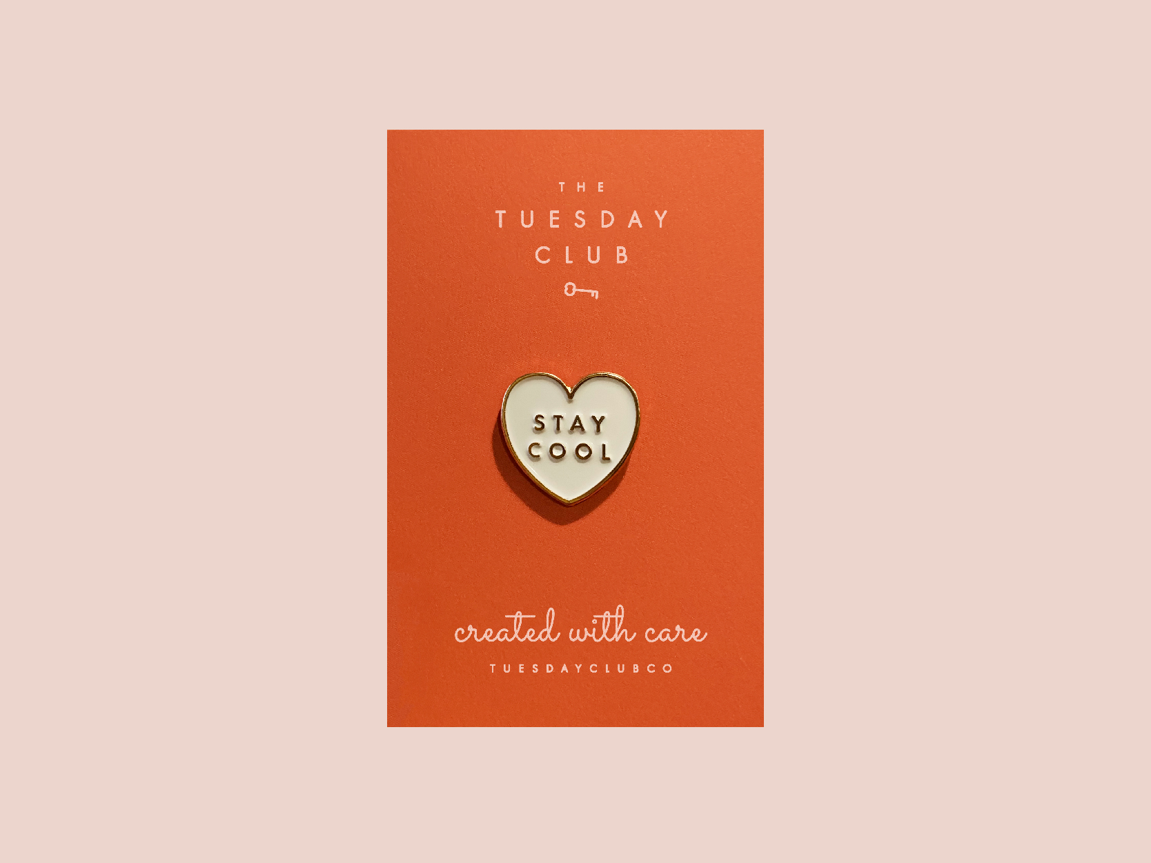 "Heart-shaped ""Stay Cool"" pin."