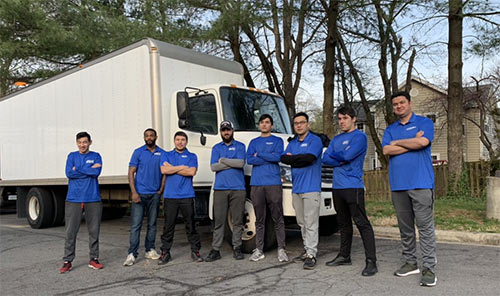 Our moving team in front of one of our moving trucks.