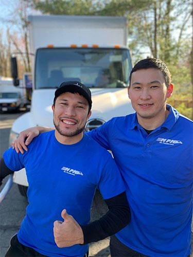 MyProMovers owner Tony Alkau (left) and mover Duman.