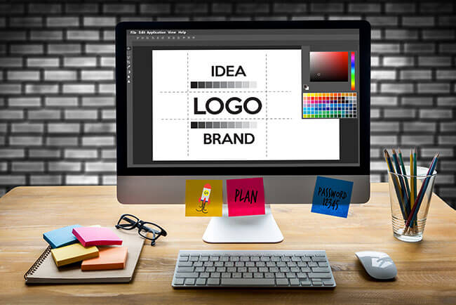 An imac showing logo design