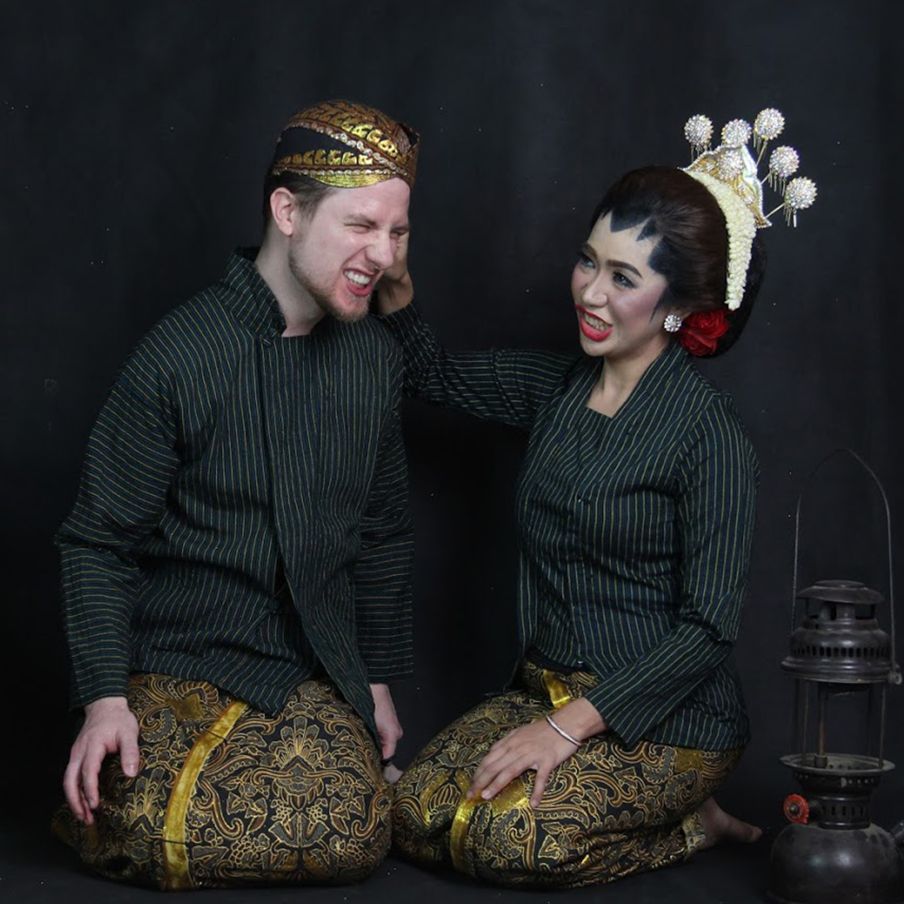 Picture of me and my wife in Javanese dress being silly.