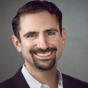 Headshot of Chief Strategy Officer Joshua Levin.