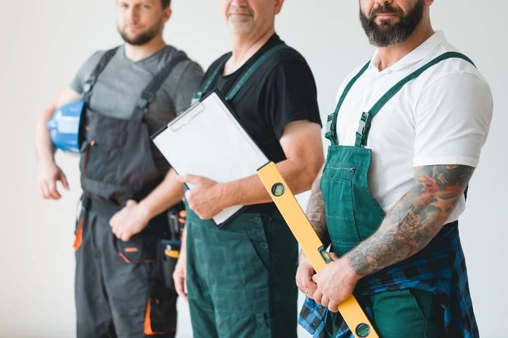 home service workers holding tools and clipboard