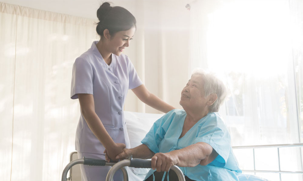 Vencer healthcare provider helping an elderly woman