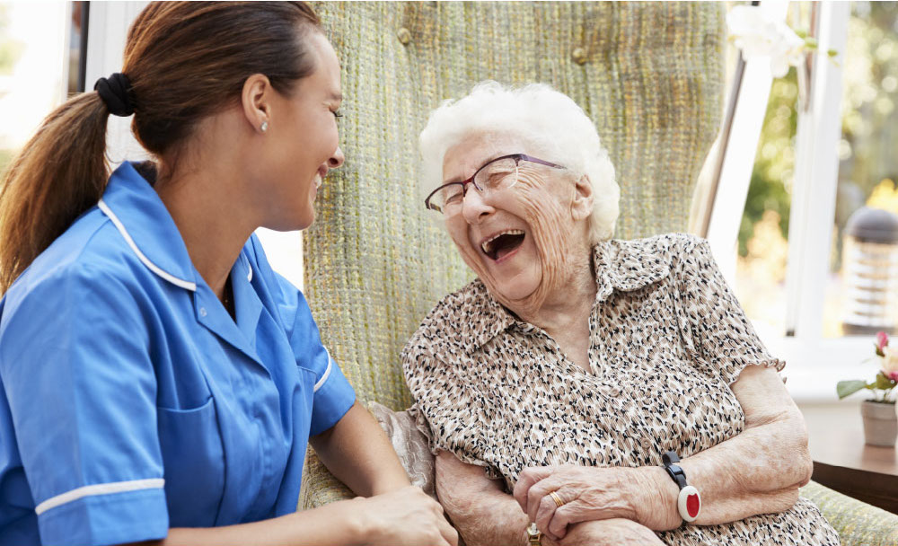 Home healthcare provider assisting elderly woman