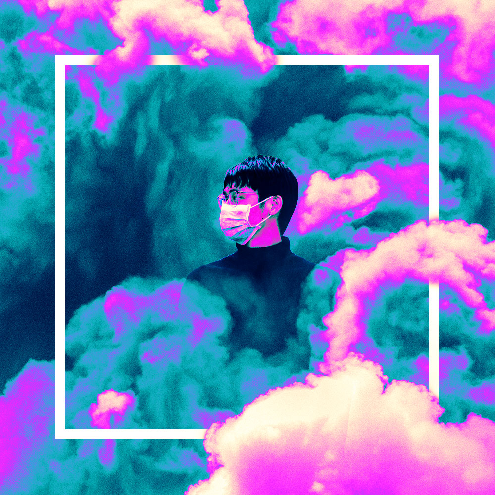 man in clouds wearing a surgical mask