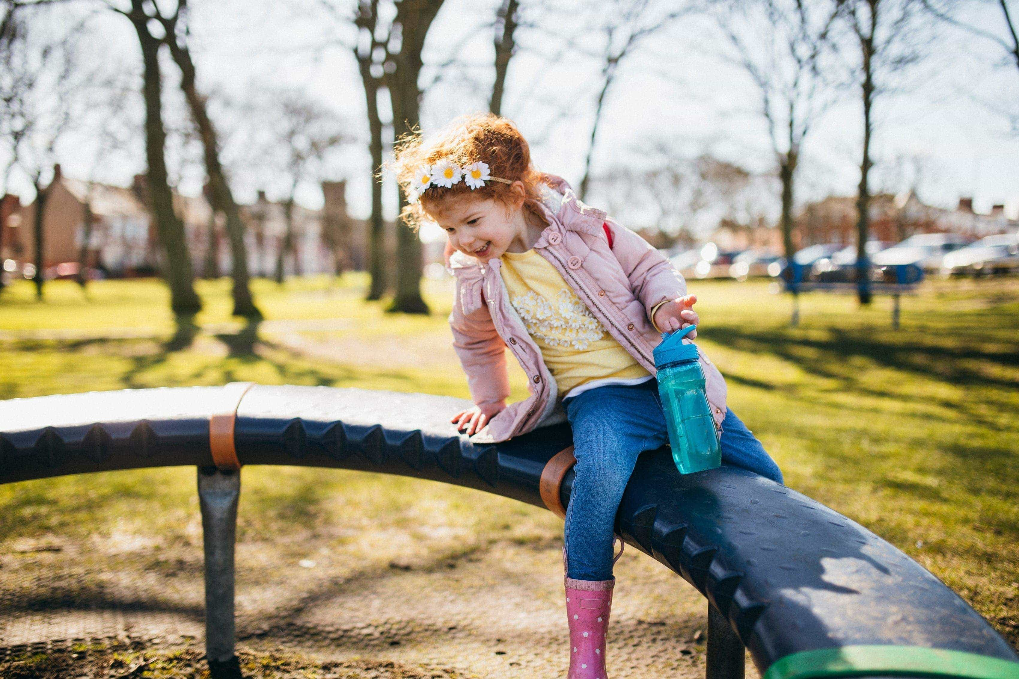 A young girl playing in a park