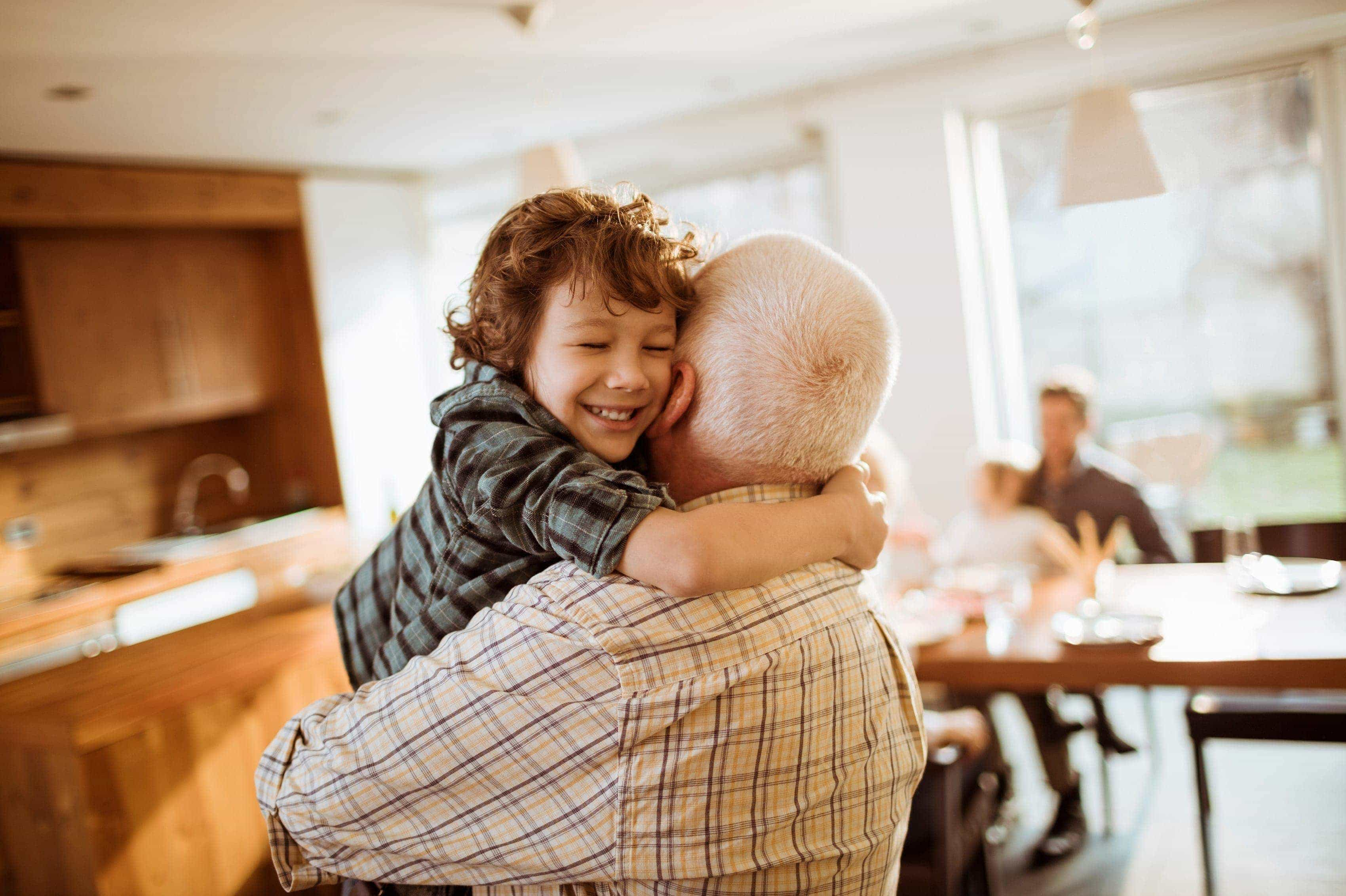 A grandson hugging his grandpa