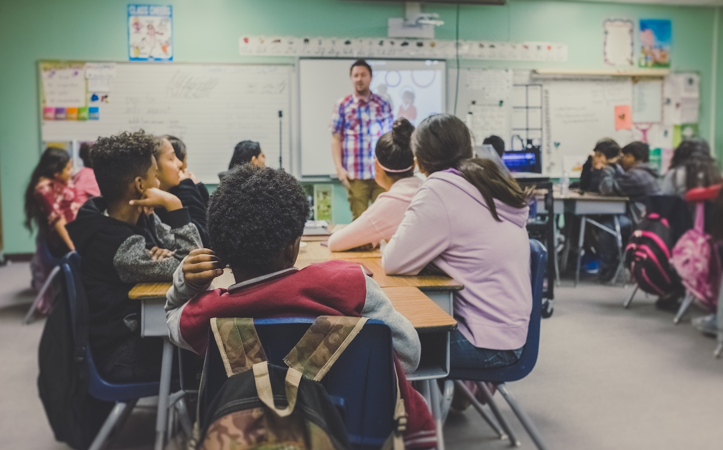 A tuition centre's classroom full of students and a teacher