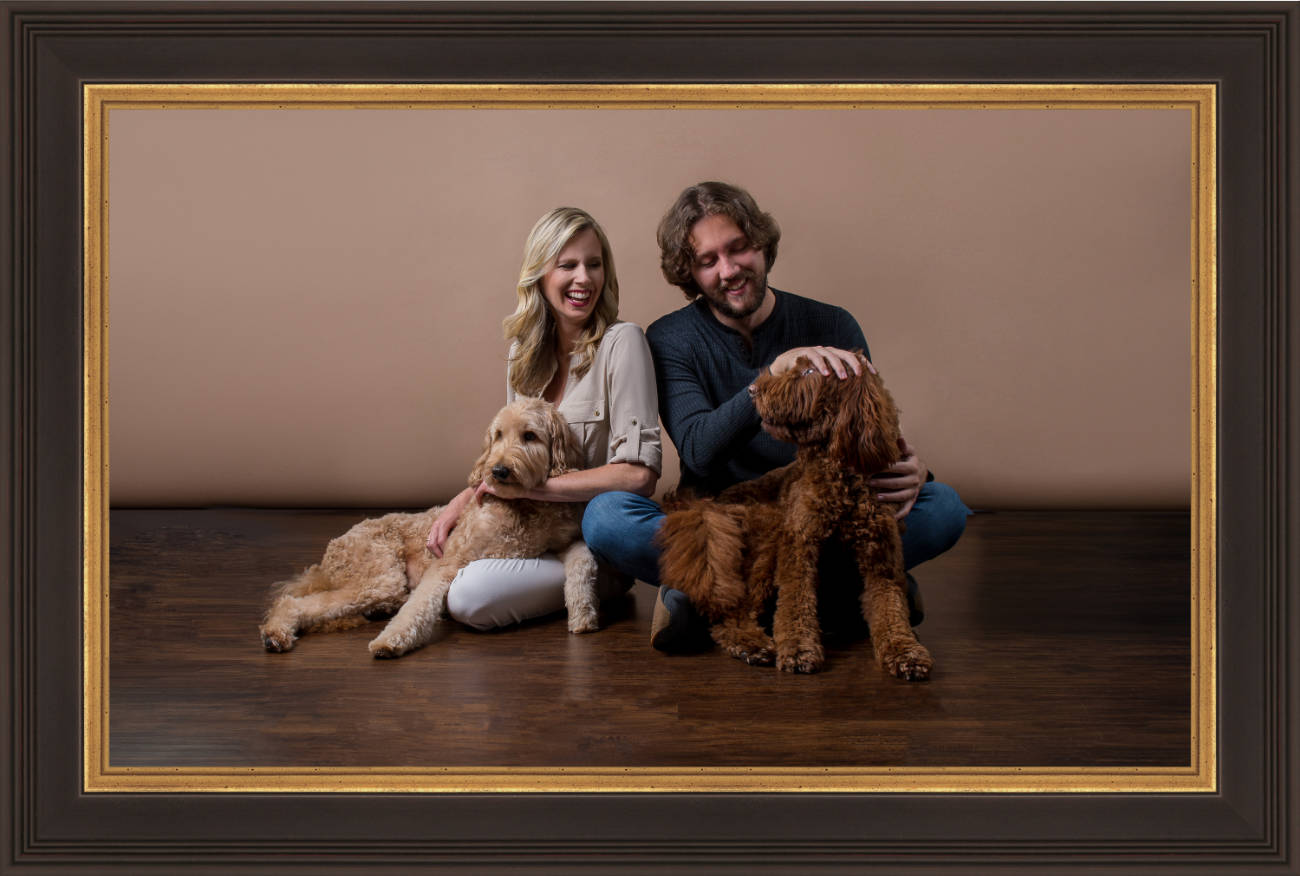 A young couple with their two dogs
