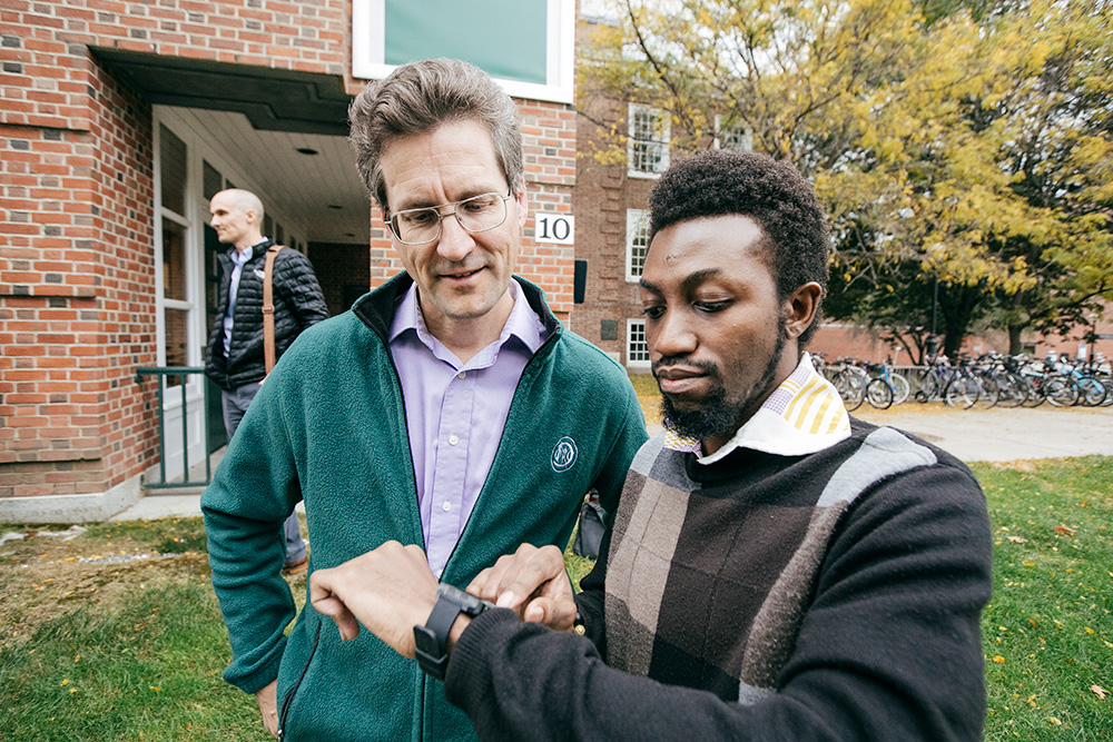 "Professor David Kotz '86 (left) and George Boateng have worked together on the Amulet, a type of ""computational jewelry."""