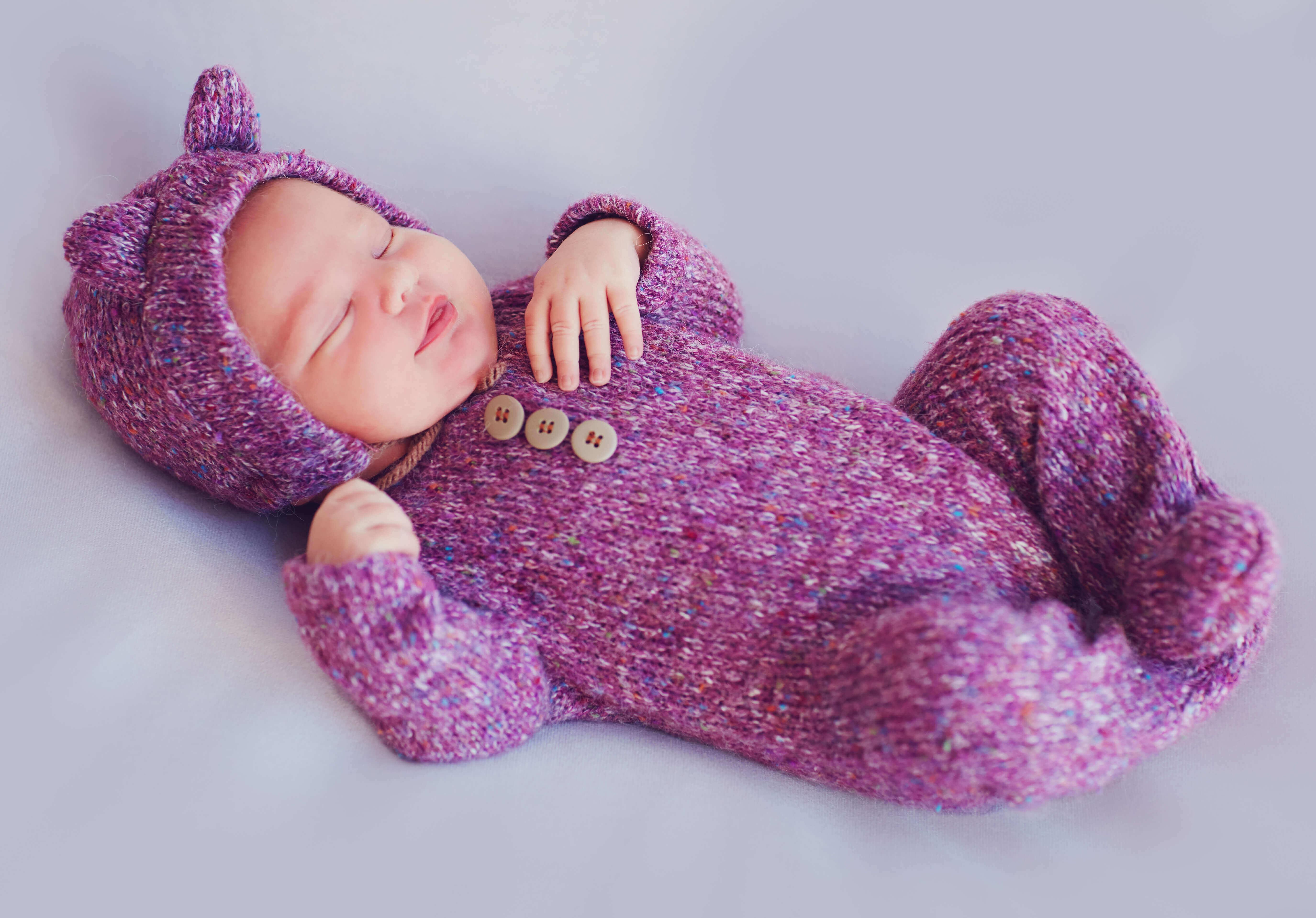 baby sleeping in a winter dress