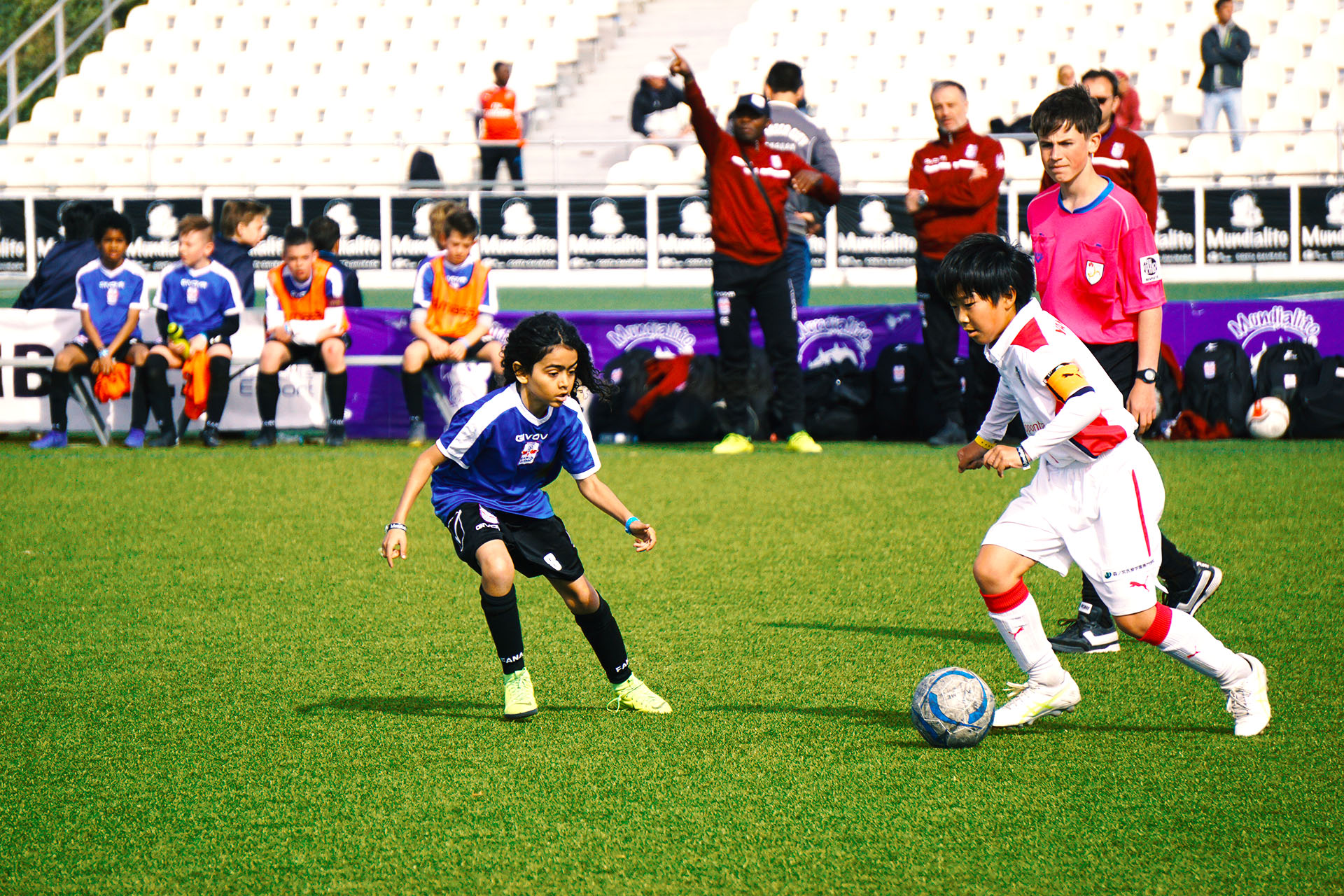 Kid from team Cerezo Osaka faces an opponent during a match in Mundialito 2019 in Catalyuna, Spain