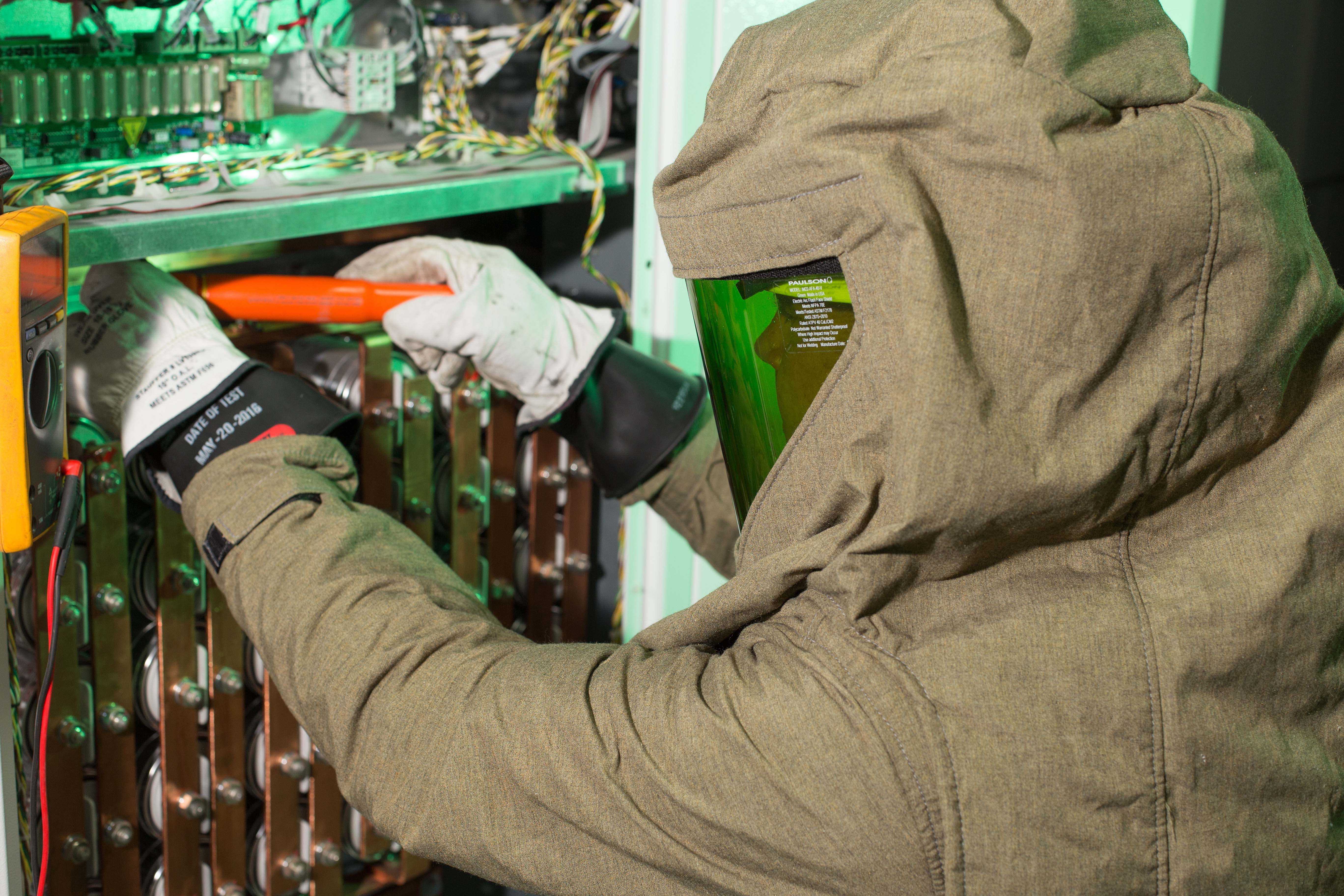 A field engineer replacing parts on a UPS.