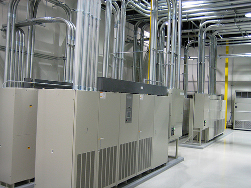 This is a room that houses UPS units. UPS (uninterruptible power supply systems) provide a clean source of power for our clients.